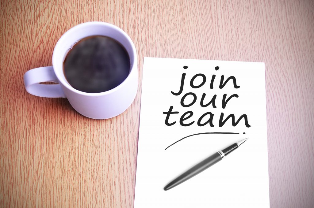 Black coffee on the table with note writing join our team